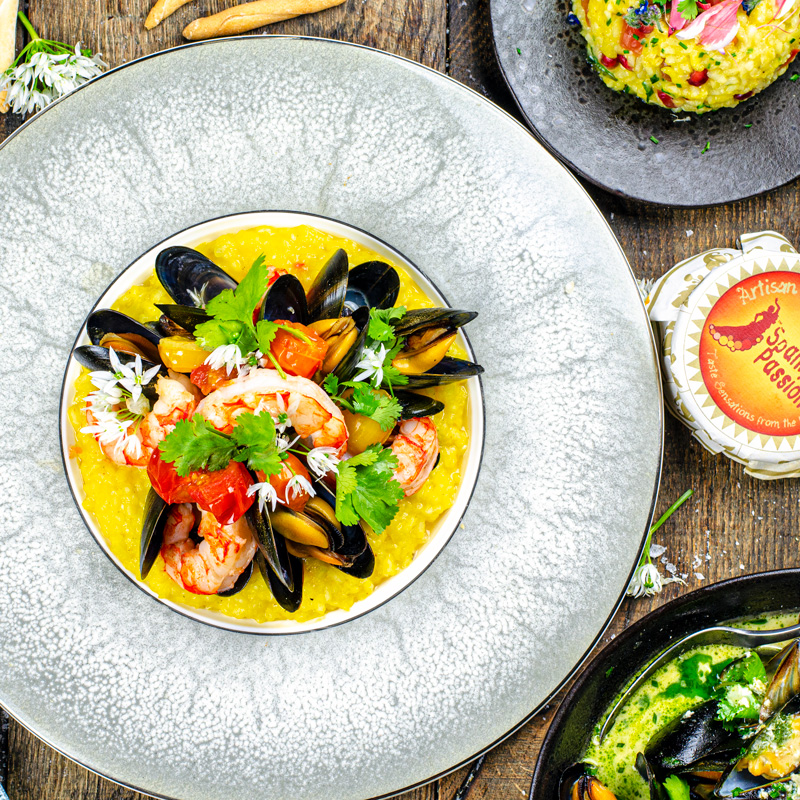 Saffron Risotto with Argentinian Red Prawns, Mussels and Cherry Tomatoes.