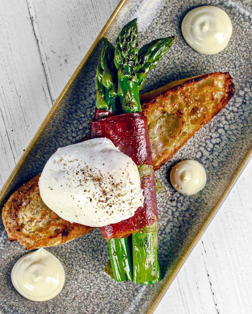 Asparagus, Serrano Ham, Soft Poached Egg. Olive oil croute, Allioli Mayonnaise
