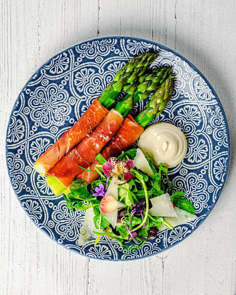 Serrano wrapped English Asparagus,Aioli Mayonnaise, Pea shoot and Watercress salad.
